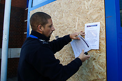 © Licensed to London News Pictures. 12/11/2020. London, UK. A police officer puts a notice on the entrance to Edmonton Police Station in north London which is boarded up following an incident where a vehicle was driven into the police station just before 7pm on Wednesday, 11 November. A 45-year-old man left the vehicle before attempting to set fire to it using petrol. He was arrested by officers on suspicion of arson and is remanded in custody. The incident is not being treated as terror-related. Photo credit: Dinendra Haria/LNP