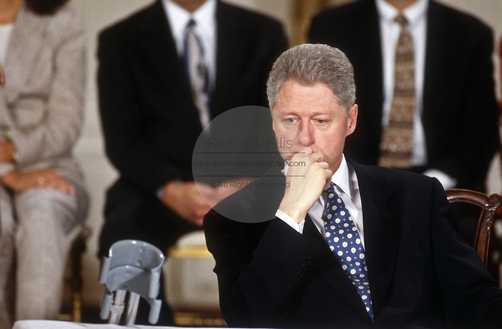 President Bill Clinton pauses in thought during a White House event, March 26, 1997, where he named a commission to look into Americans concerns about managed health care in Washington, DC.