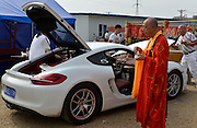 That's one way to make a FAST buck! Buddhist monks break their 'three poisons' rule by accepting cash to bless businessman's Porsche<br /> <br /> A Buddhist Chinese monk has caused controversy after it emerged he had accepted cash to bless a businessman's Porsche. <br /> <br /> Recently everything from palatial new homes to controversial business ventures are beginning to be blessed, but it was the businessman's request to have his brand-new sports car prayed over in a temple in the city of Xiaogan, in eastern China's Hubei province, that has really caused anger across the country.<br /> <br /> Software development company boss Tao Hung brought the high-performance car to the monk so he could pray that he would drive safely in the vehicle and be 'lucky' in always reaching his destinations on time without incident.<br /> But critics have said that the blessing goes against Buddhist tradition and that greed and money are not part of the teachings - in fact greed, hatred, and delusion are known as the three poisons.<br /> Several people also branded the blessing pointless saying that if the man wanted to avoid accidents, he should drive slowly and take care not to count on God to do the job for him.<br /> One commentator writing online said: 'He may have money but one wonders how he came to make it, given the fact that he shows an eminent lack of intelligence.'<br /> <br /> The businessman himself declined to comment and the monks said that blessing means of transportation has always been part of their Buddhist tradition and there was nothing wrong with agreeing to pray that the man's Porsche delivered him safely after each journey. <br /> ©Exclusivepix