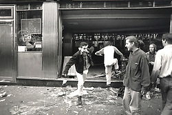 © Licensed to London News Pictures. 25/03/2020. London, UK. In this image from March 31st 1990 looters break into a branch of Barclays Bank on Charing Cross Road during the London poll tax riots. The protest on the last day of March in 1990 started peacefully when thousands gathered in a south London park to demonstrate against Margaret Thatcher's Government's introduction of the Community Charge - commonly known as the poll tax. Marchers walked to Whitehall and Trafalgar Square where violence broke out with the trouble spreading up through Charring Cross Road and on to the West End. Police estimated that 200,000 people had joined the protest and 339 were arrested. The hated tax was eventually replaced by the Council Tax under John Major's government in 1992.  Photo credit: Peter Macdiarmid/LNP
