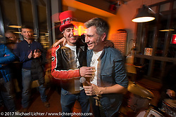 Nicola Martini (in the red hat) at his Mr Martini party in his downtown shop - restaurant after the first day of Motor Bike Expo. Verona, Italy. Friday January 20, 2017. Photography ©2017 Michael Lichter.