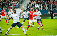 SAINT PETERSBURG, RUSSIA - MARCH 27: RUSSIA-FRANCE. International friendly football match at Saint Petersburg Stadium on March 27, 2018 in Saint-Petersburg, Russia. France's Olivier Giroud (L), Samuel Umtiti (C),  Russian's Anton Shvets (C) and French's Adrien Rabiot (R). (Photo by MB Media/Getty Images)