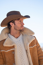 profile of a sexy cowboy in a shearling coat
