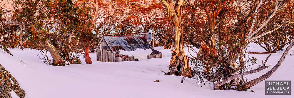 Sunset setting with last rays of sunlight illuminating the snow gums surrounding Wallace's Hut, Victorian High Country.<br /> <br /> Limited Edition of 125 prints