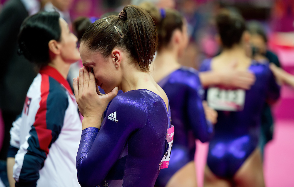 Jordyn Wieber of the United States, left, wept after the final team and individual standings were displayed on the scoreboard following women's team gymnastics preliminaries competition at North Greenwich Arena during the 2012 Summer Olympic Games in London, England, Sunday, July 29, 2012. At far right, teammates congratulate Alexandra Raisman on her scores. (David Eulitt/Kansas City Star/MCT)