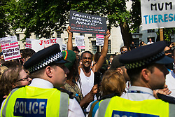 London, June 21st 2017. Protesters march through London from Sheherd's Bush Green in what the organisers call 'A Day Of Rage' in the wake of the Grenfell Tower fire disaster. The march is organised by the Movement for Justice By Any Means Necessary and coincides with the Queen's Speech at Parliament, the destination. PICTURED: A man's banner demands a 'People's Inquiry'.