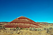 A single red hill or mound at the Painted Hills area of eastern Oregon, outside Mitchell, Oregon