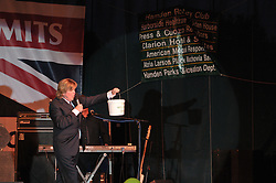 Peter Noone of the Herman's Hermits passing the collection bucket while  performing at the Hamden Free Summer Concert Series July 2009