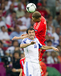16-06-2012 VOETBAL: UEFA EURO 2012 DAY 9: POLEN OEKRAINE<br /> Giorgos Karagounis  of Greece vs Aleksei Berezutski of Russia during the UEFA EURO 2012 group A match between  Greece and Russia at The National Stadium<br /> ***NETHERLANDS ONLY***<br /> ©2012-FotoHoogendoorn.nl