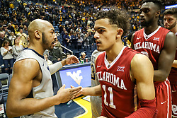 Jan 6, 2018; Morgantown, WV, USA; West Virginia Mountaineers guard Jevon Carter (2) and Oklahoma Sooners guard Trae Young (11) talk after the game at WVU Coliseum. Mandatory Credit: Ben Queen-USA TODAY Sports