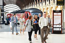 Passengers alighting from Virgin train, York Railway Station platform UK