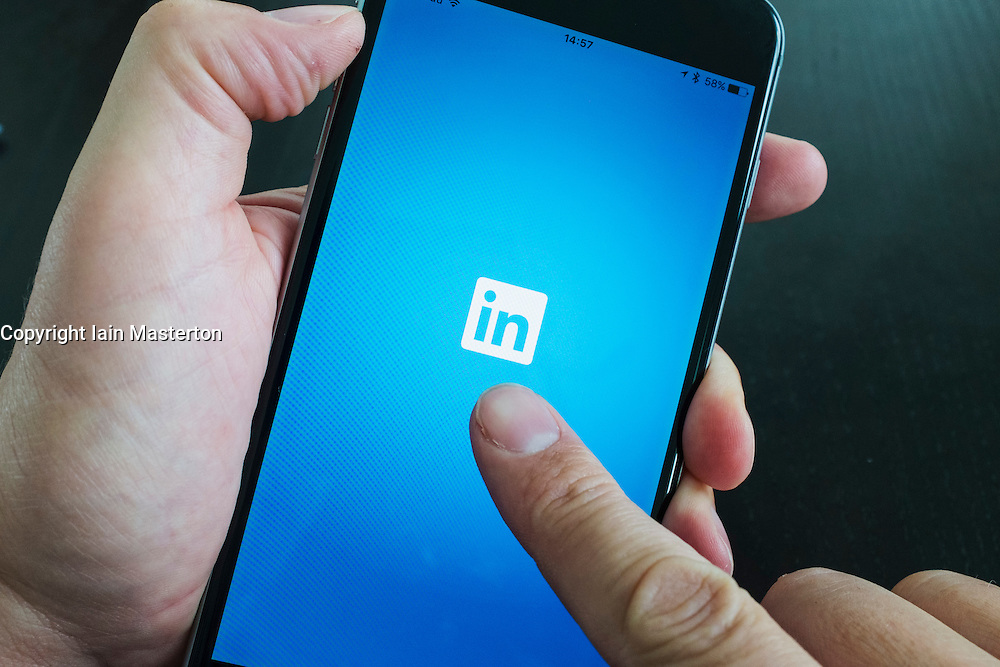 LinkedIn professional social networking app logo on screen of iPhone 6 Plus smart phone