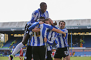 Sheffield Wednesday striker Gary Hooper (14) is mobbed by his players after his opening goal 1-0 during the Sky Bet Championship match between Sheffield Wednesday and Cardiff City at Hillsborough, Sheffield, England on 30 April 2016. Photo by Phil Duncan.