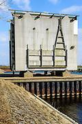 Nederland, Zeeland, Gemeente Noord-Beveland, 16-03-2016; Kats, Zandkreekdam. Reserve  sluisdeuren, naast de sluis op land opgeslagen.<br /> <br /> copyright foto/photo Siebe Swart