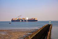 container ship on the Western Scheldt off the coast of Vlissingen, Walcheren, Zeeland, Netherlands.<br /> <br /> Containerschiff auf der Westerschelde vor Vlissingen, Walcheren, Zeeland, Niederlande.