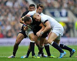 Israel Dagg (New Zealand) is tackled in possession - Photo mandatory by-line: Patrick Khachfe/JMP - Tel: Mobile: 07966 386802 16/11/2013 - SPORT - RUGBY UNION -  Twickenham Stadium, London - England v New Zealand - QBE Autumn Internationals.