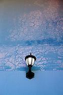Lamp and wall in Gibara, Holguin, Cuba.