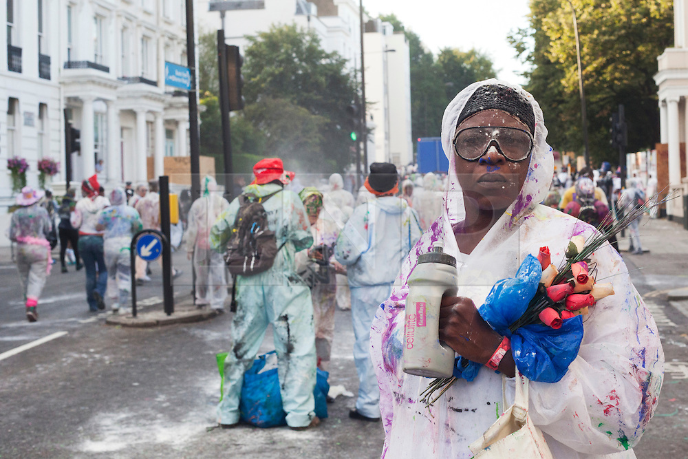 © Licensed to London News Pictures. 26/08/2012. London, England. The Notting Hill Carnival 2012 kicks off with the traditional early morning J'ouvert (or Jouvert) parade where flour and paint is thrown. Photo credit: Bettina Strenske/LNP