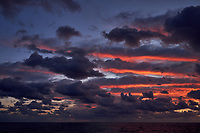 Colorful Dawn clouds over the Pacific Ocean from the deck of the MV World Odyssey. Image 1 of 6 taken with a  Fuji X-T1 camera and 23 mm f/1.4 lens (ISO 200, 23 mm, f/5.6, 1/60 sec). Raw images processed with Capture One Pro.