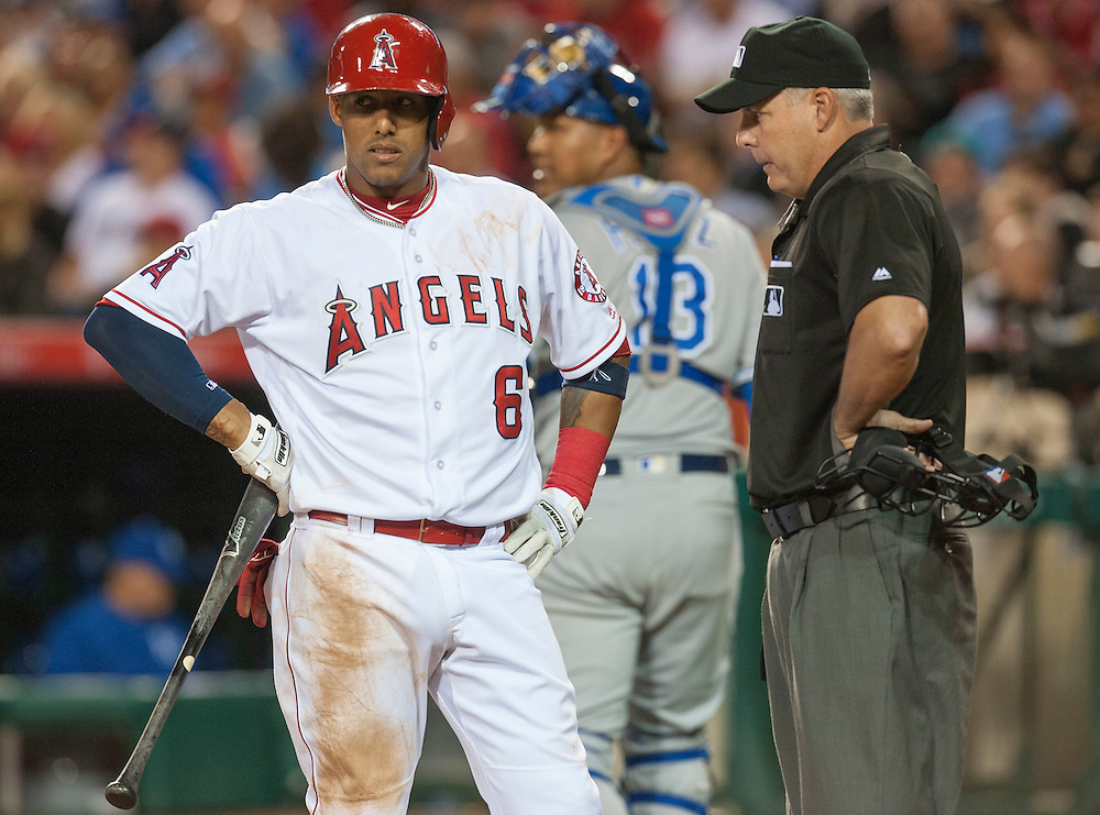 The Angels Yunel Escobar doesn't seem happy with home plate umpire Tim Timmons after he struck out against the Kansas City Royals Wednesday night at Angel Stadium.<br /> <br /> ///ADDITIONAL INFO:   <br /> <br /> angels.0428.kjs  ---  Photo by KEVIN SULLIVAN / Orange County Register  --  4/27/16<br /> <br /> The Los Angeles Angels take on the Kansas City Royals Wednesday at Angel Stadium.<br /> <br /> <br />  4/27/16