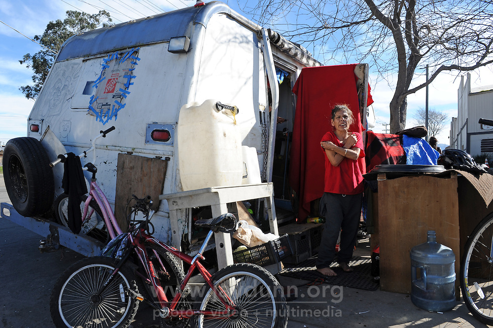 Diana Soto, 60, in the doorway of the mobile home she shares with Angel Menchaca and their two dogs in Salinas' Chinatown.
