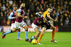 Jack Grealish of Aston Villa is challenged by Dave Edwards of Wolverhampton Wanderers - Mandatory by-line: Dougie Allward/JMP - 14/01/2017 - FOOTBALL - Molineux - Wolverhampton, England - Wolverhampton Wanderers v Aston Villa - Sky Bet Championship