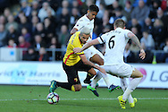 Valon Behrami of Watford © is squeezed out by Alfie Mawson (6) and Kyle Naughton of Swansea city. Premier league match, Swansea city v Watford at the Liberty Stadium in Swansea, South Wales on Saturday 22nd October 2016.<br /> pic by  Andrew Orchard, Andrew Orchard sports photography.