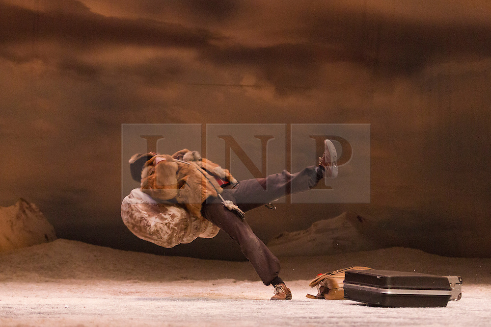 """© Licensed to London News Pictures. 27/01/2015. London, England. Pictured: Seoljin Kim performing. Belgian dance collective Peeping Tom presents their piece """"32 rue Vandenbranden"""" at the Barbican Theatre in association with London International Mime Festival (LIMF) from 28 to 31 January 2015. Show was conceived and directed by Gabriela Carrizo and Franck Chartier with Seoljin Kim, Hun-Mok Jung, Marie Gyselbrecht, Jos Baker, Maria Carolina Vieira and Euridike De Beul performing. Photo credit: Bettina Strenske/LNP"""