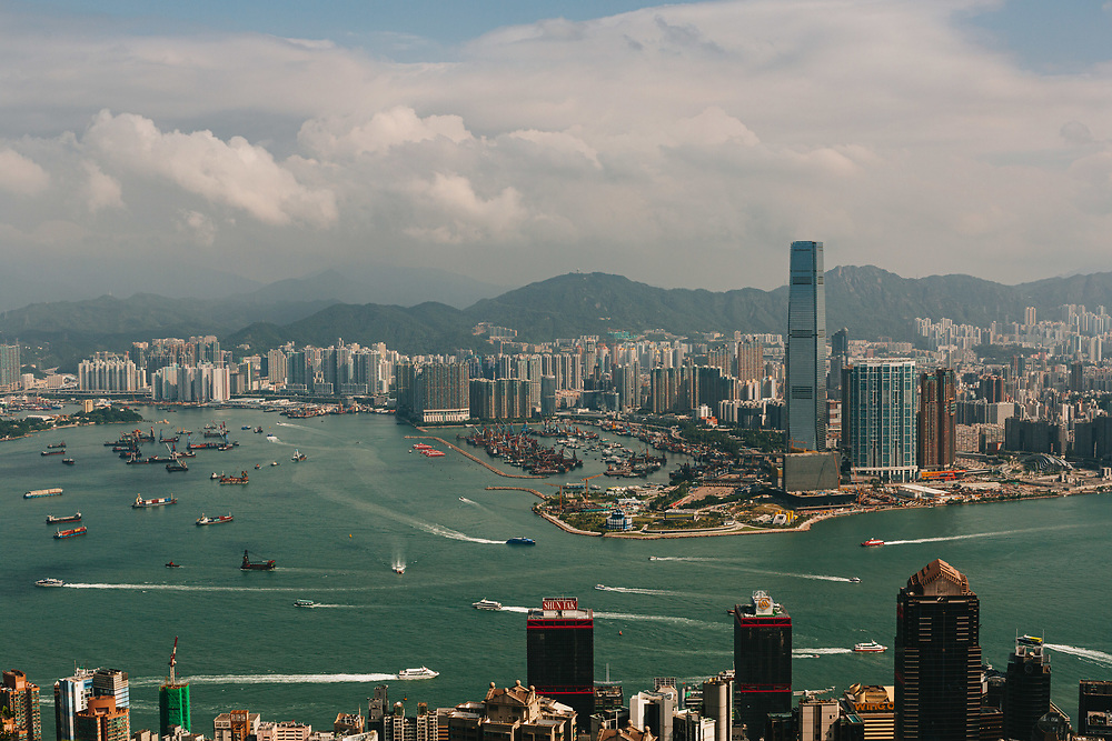 A general view of the Hong Kong skyline and Victoria Harbor,  from Victoria Peak shows commercial and residential buildings in Kowloon (background) and Hong Kong Island (foreground), Hong Kong, China, on October 15, 2019.