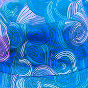 Psychedelic twirling design in blue, red and purple