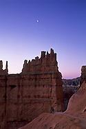 Crescent moon at dawn over Hoodoos and photographer, Navajo Loop Trail, Bryce Canyon National Park, UTAH