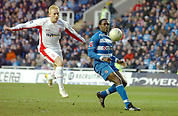 Photo: Kevin Poolman.<br />Reading v Birmingham City. The FA Cup. 28/01/2006.<br />Birmingham's Mikael Forssell (L) can't quite get to the ball infront of Ibrahima Sonko.