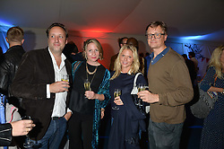 Left to right, MATTHEW HOBBS, CLARE SCHILLING, CARRIE HOBBS and PROF.RICHARD SCHILLING at the World's Greatest Quiz Night in aid of the Quintessentially Foundation and Dimbleby Cancer Care held at the Riverside Parliament Panorama marquee at St Thomas' Hospital, Westminster Bridge Road, Londonon 15th September 2015.