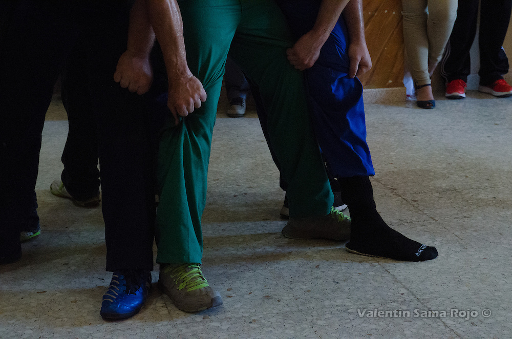 Detail of the hands of the men performing a human tower during the rehearsal of Cetina's Contradanza in 'San Juan Lorenzo' hermitage.
