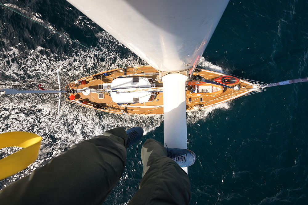 On top of sailboat mast, to watch the ice conditions in Antarctica