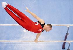 Adam Kierzkowski of Poland competes in the Parallel Bars during Final day 2 of Artistic Gymnastics World Cup Ljubljana, on April 27, 2013, in Hala Tivoli, Ljubljana, Slovenia. (Photo By Vid Ponikvar / Sportida.com)