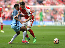 23 April 2017 FA Cup semi-final : Arsenal v Manchester City :<br /> Mesut Ozil of Arsenal is dispossessed by Raheem Sterling.<br /> Photo: Mark Leech