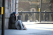 Homeless people in the United Kingdom facing the risk of death from Coronavirus. Last years alone, 320,000 people were recorded as homeless in Britain, analysis from housing charity Shelter suggests. It is a rise of 13,000, or 4%, on last year's figures and equivalent to 36 new people becoming homeless every day.<br /> In this picture, a homeless man is seating at the London Bridge Station on Sunday, March 22, 2020. For most people, the new coronavirus causes only mild or moderate symptoms, such as fever and cough. For some, especially older adults and people with existing health problems, it can cause more severe illness, including pneumonia. <br /> (Photo/Vudi Xhymshiti)