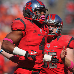 Oct 13, 2012: Rutgers Scarlet Knights wide receiver Leonte Carroo (4) celebrates a tackle with long snapper Robert Jones (85) during NCAA Big East college football action between the Rutgers Scarlet Knights and Syracuse Orange at High Point Solutions Stadium in Piscataway, N.J.