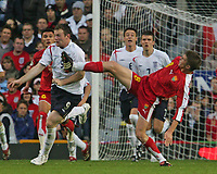 Photo: Andrew Unwin.<br />England v Macedonia. UEFA European Championships 2008 Qualifying. 07/10/2006.<br />England's Wayne Rooney (L) battles with Macedonia's Veliche Sumulikoski (R).