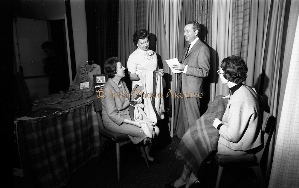 05/04/1965<br /> 04/05/1965<br /> 05 April 1965<br /> Second Irish Export Fashion Fair opened at the Intercontinental Hotel, Dublin. Picture shows (l-r):  Lady Audrey Garnham, (London); Mrs Frances Ziegler, Business Manager, Hess's, Allentown, Pennsylvania, U.S.A. and Mr. Gerry Golden, Fashion Director, Hess's, viewing Irish Tweed on the Crock of Gold stand at the fair with Mrs Veronica Rowe (Crock of Gold) right.