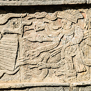 A carving in a stone wall depicting a Mayan warrior at Chichen Itza, Mexico.