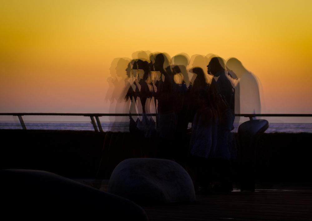 Sunset in Tel Aviv. Marching silhouettes