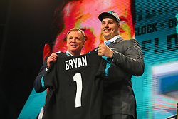April 26, 2018 - Arlington, TX, U.S. - ARLINGTON, TX - APRIL 26: Taven Bryan holds up a jersey and takes photos with NFL Commissioner Roger Goodell after being chosen by the Jacksonville Jaguars with the 29th pick during the first round at the 2018 NFL Draft at AT&T Statium on April 26, 2018 at AT&T Stadium in Arlington Texas.  (Photo by Rich Graessle/Icon Sportswire) (Credit Image: © Rich Graessle/Icon SMI via ZUMA Press)