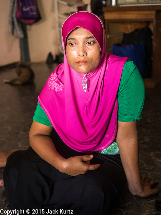 01 JUNE 2015 - KULAI, JOHORE, MALAYSIA:  MURIAH, a Rohingya refugee in Kulai, Malaysia, said her husband and some of her children were killed by Buddhist mobs during sectarian violence against the Rohingya in Rakhine state of Myanmar. She came to Malaysia after the riots and spent 11 days on a boat with 500 other Rohingya refugees. She said the Indian Navy helped them once with food and water and pointed them in the direction of Malaysia. The UN says the Rohingya, a Muslim minority in western Myanmar, are the most persecuted ethnic minority in the world. The government of Myanmar insists the Rohingya are illegal immigrants from Bangladesh and has refused to grant them citizenship. Most of the Rohingya in Myanmar have been confined to Internal Displaced Persons camp in Rakhine state, bordering Bangladesh. Thousands of Rohingya have fled Myanmar and settled in Malaysia. Most fled on small fishing trawlers. There are about 1,500 Rohingya in the town of Kulai, in the Malaysian state of Johore. Only about 500 of them have been granted official refugee status by the UN High Commissioner for Refugees. The rest live under the radar, relying on gifts from their community and taking menial jobs to make ends meet. They face harassment from Malaysian police who, the Rohingya say, extort bribes from them.       PHOTO BY JACK KURTZ