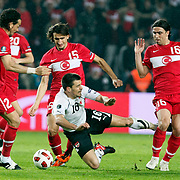 Turkey's Mehmet TOPUZ (R), Mehmet TOPAL (B) and Austria's Paul SCHARNER (C) during their UEFA EURO 2012 Qualifying round Group A soccer match Turkey betwen Austria at Sukru Saracoglu stadium in Istanbul March 29, 2011. Photo by TURKPIX