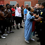 """Alfreada Radford Tucker, grandmother of Lamar Richardson, is distraught as she approaches the police line as people gather near the scene of a shooting near LaGrange and Hudson streets in Toledo on Friday, July 27, 2018. Richardson, the 25-year-old man who was shot and killed by police, was described by Toledo Police as a """"person of Interest"""" in multiple robberies. Police fired at him after he """"produced a weapon."""" THE BLADE/KURT STEISS"""