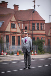 © Licensed to London News Pictures.29/05/2013.LONDON UK.. ABP (Asian Business Port) chairman Mr Xu Weiping on the  derelict site at Royal Albert Dock in East London. Plans to create a multi-million pound Chinese business park on the 35-acre site at London's Royal Docks have been revealed at City Hall earlier in the day..Photo credit : ANDREW BAKER/LNP