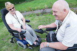 Disabled couple sitting in their garden together,