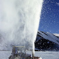 ANTARCTICA, Tractor plows rare, deep snow off ice runway at Patriot Hills Base in the Ellsworth Mts.